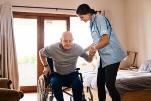 Home Healthy Nurse Helping Her Patient Walk