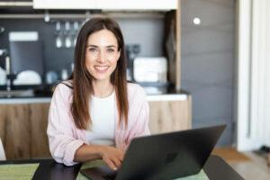 The Senior Affiliate- online. Freelancer typing at home office, workplace.